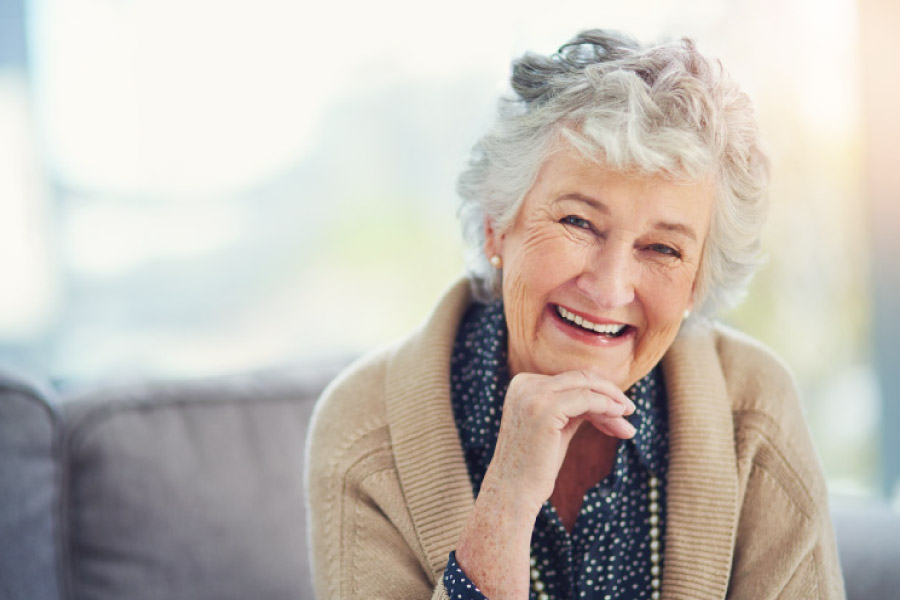 Smiling sweet faced older woman with dentures