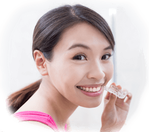 young woman with a whitening tray